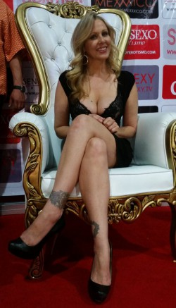 Julia Ann shows leg tattoos