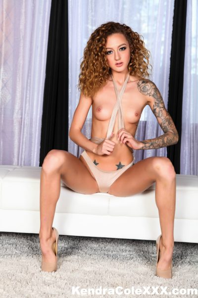 topless Kendra Cole shows her arm sleeve tattoos