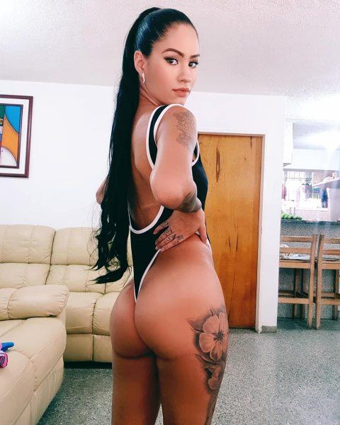 SuicideGirls model Kreys Alejandra shows her leg tattoo