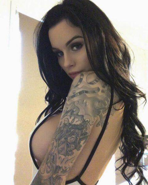 Australian model Sharnilee shows her arm tattoos