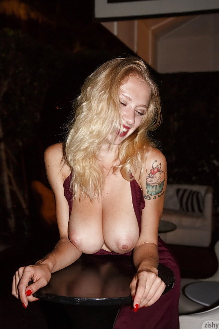 Natasha Legeyda shows her upper arm tattoo