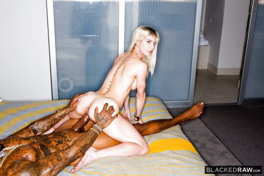 pornstar Cassie Bender with spinal tattoos having sex
