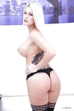 topless Blanche Bradburry shows her back tattoo